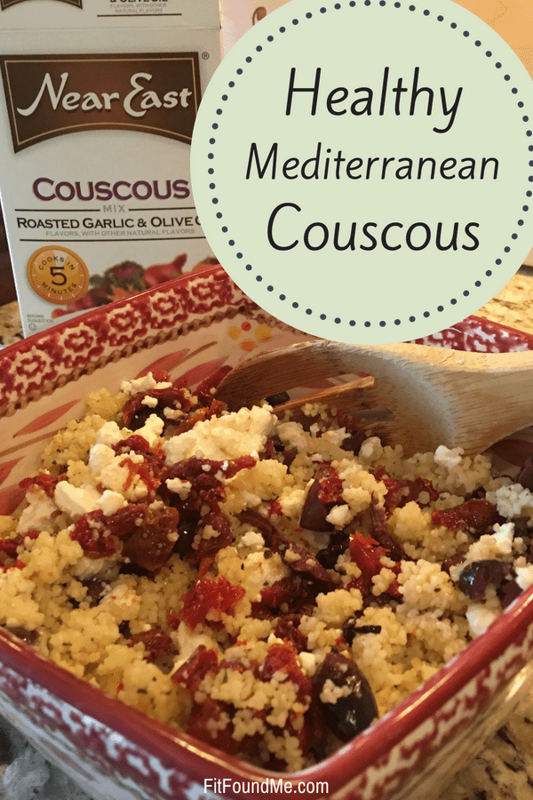 healthy Mediterranean couscous in bowl with feta cheese, olives and near east couscous