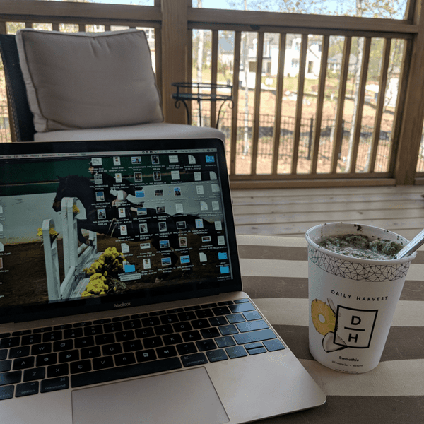 Smoothie and laptop on porch