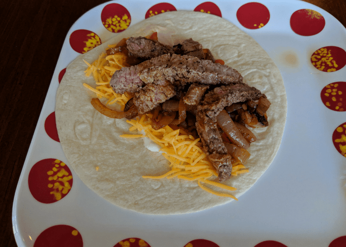steak fajitas on a plate