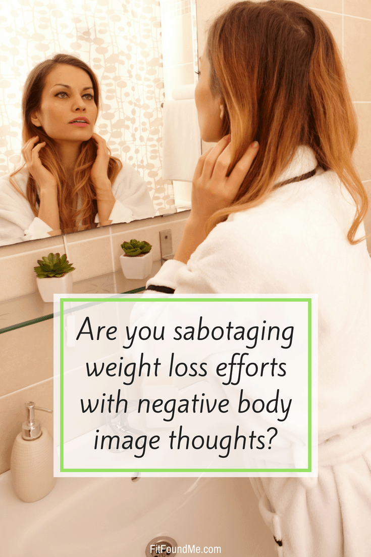 woman looking into mirror with negative body image preventing weight loss