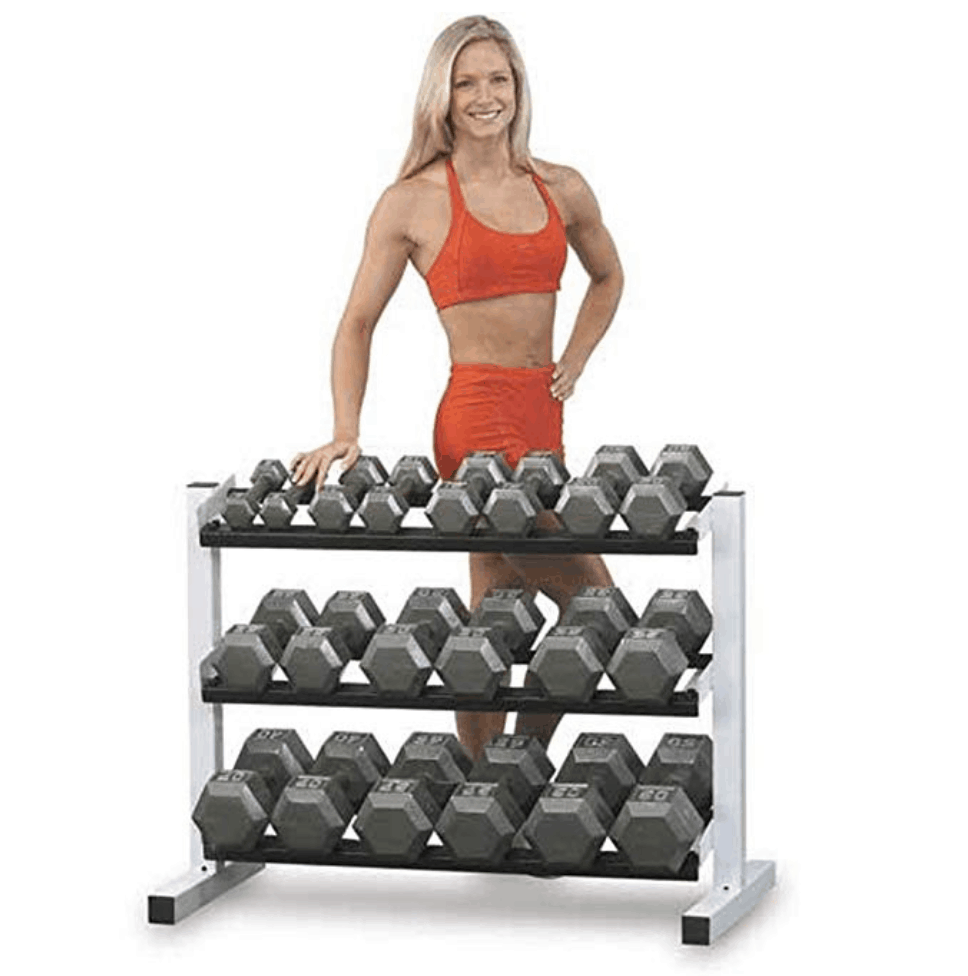 lady standing behind free weights on a rack for home gym