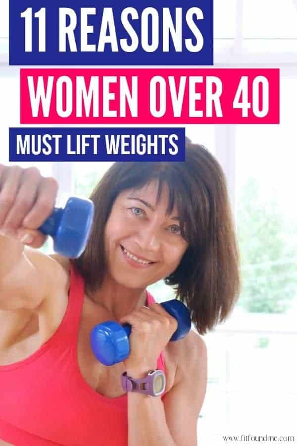 woman with hand weights looking at camera smiling