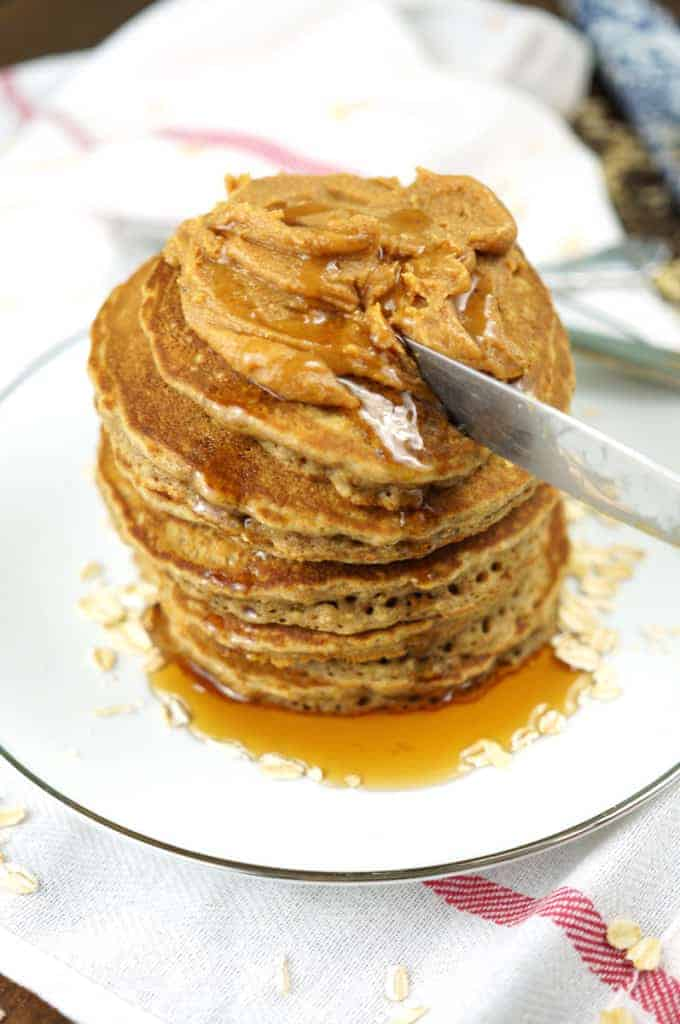 coconut chia pancakes being cut on a plate