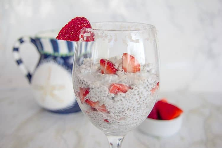 chia pudding with strawberries and coconut in a glass dish